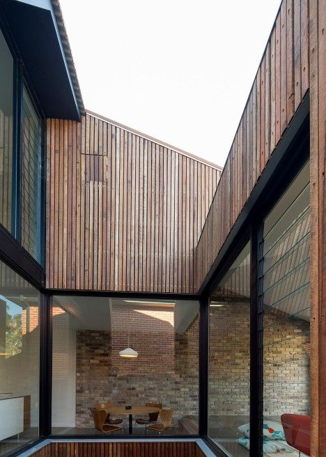 Cutaway Roof House has a courtyard sliced out of one side Scale