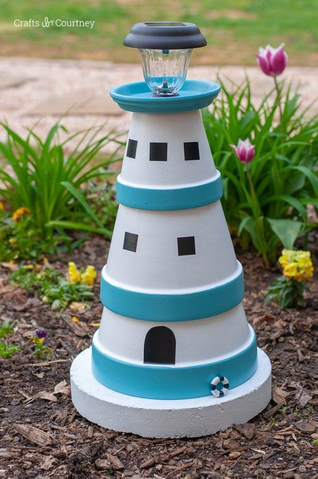 Terra Cotta Pot DIY Lighthouse Garden Project is part of Diy terra cotta pots, Diy garden projects, Clay pot lighthouse, Garden art projects, Clay pot crafts, Diy garden decor - It's never too early to start working on outdoor garden projects for your yard  I made this DIY Lighthouse with DecoArt's Outdoor Living Paints