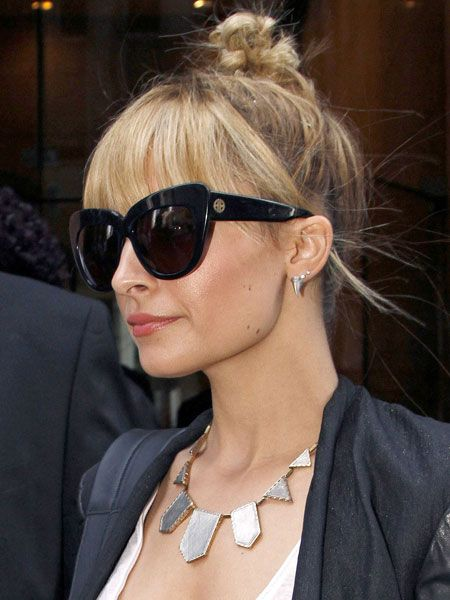 Nicole Richie's works her topknot with a full fringe and a braid. #fashion #hair #topknotbunhowto