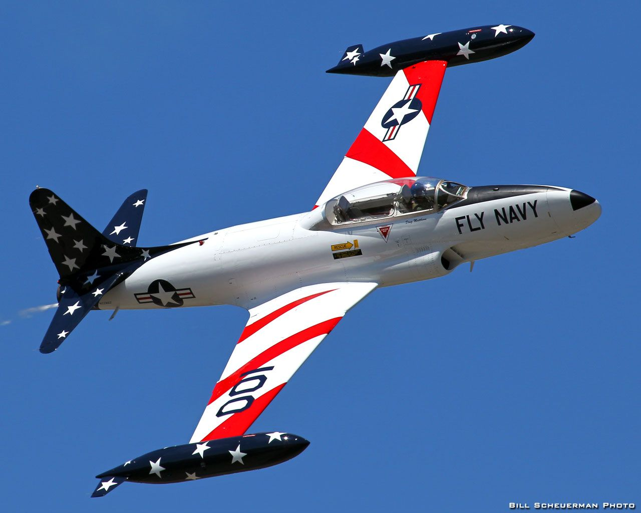 Doug Matthews flies this beautifully restored Lockheed/Canadair T-33 Silver Star. The T-33 was one of the most widely used jet trainers in the world. A two-seat version of the USAF's first jet fighter, the F-80 Shooting Star, the T-33 continues to serve in various armed forces today.