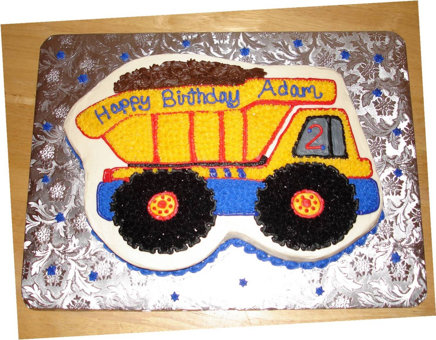 Dump truck shaped sheet cake iced in buttercream got the idea from a