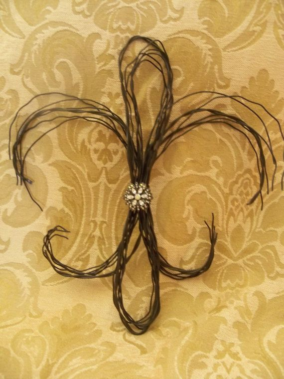 Fleur de lis. Maybe incorporate twigs or branches?