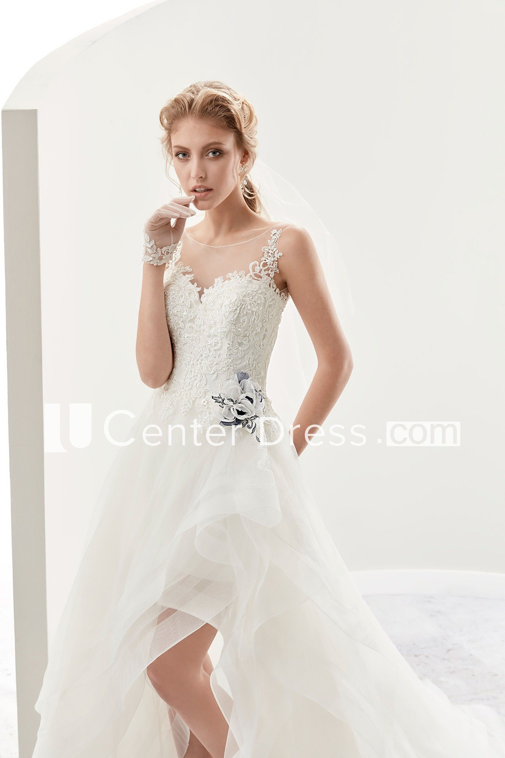 Cap sleeve highlow bridal gown with flower embellishment and