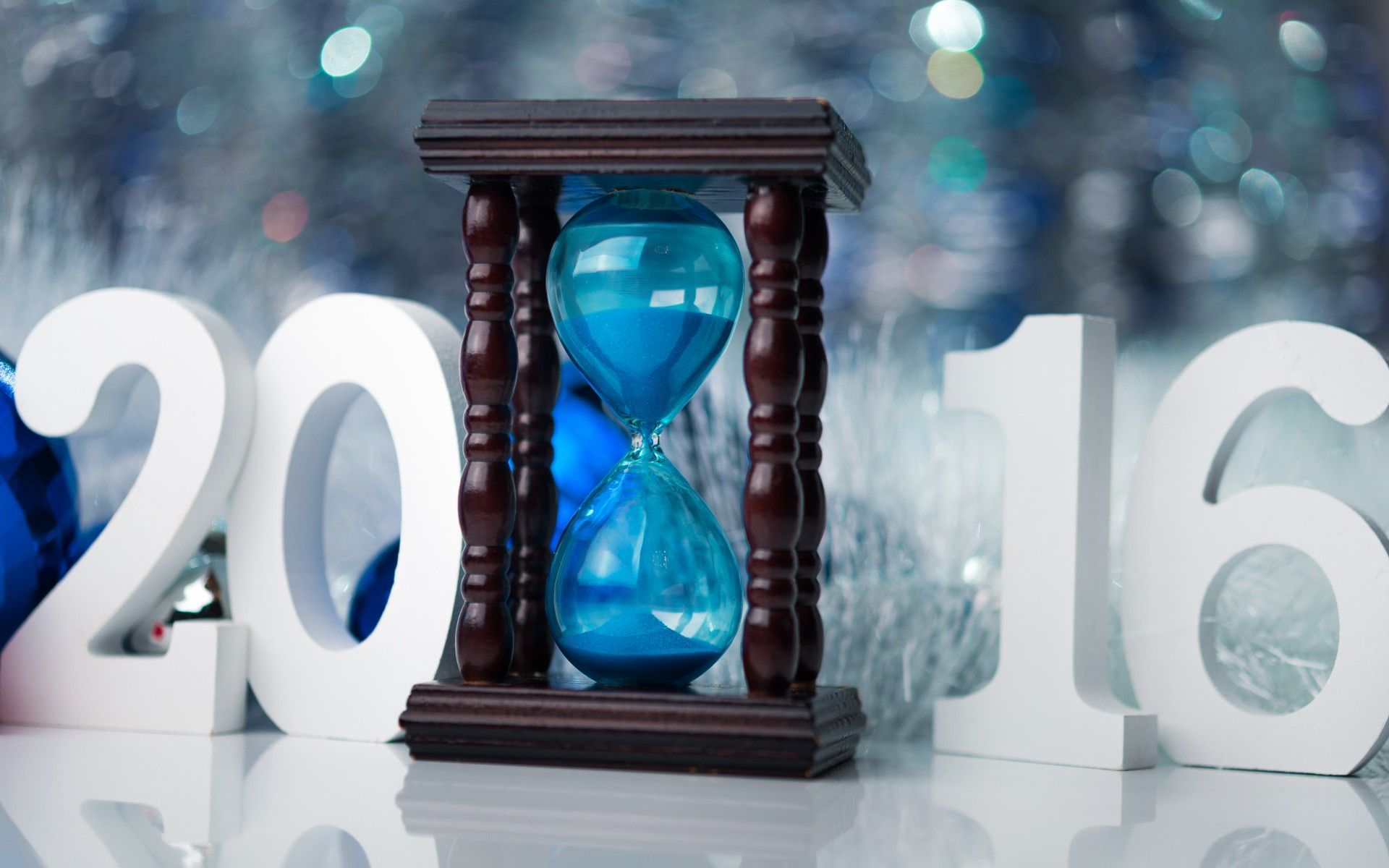 Blue hourglass - The New Year 2016 is here. Happy New Year!