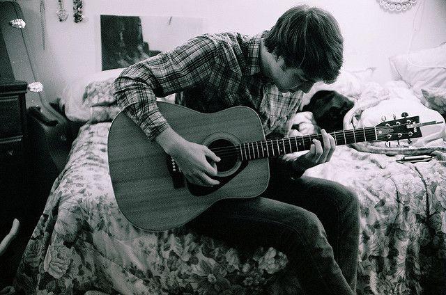 Cute Guy Playing Guitar