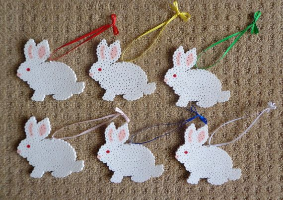 Finished set of 6 white bunny rabbit ornaments  Lovely gift tags Great Easter / Spring decorations Or, a very sweet gift for any bunny-lover to display year-round!  Handmade using perler beads (plastic tube shaped beads fused together with heat) Strung with silver-tone loop and assorted color ribbon.  Ornaments measure approximately 3.5 x 4.0 inches  Need additional sets? Please send me a message!  Our home is 100% smoke-free and shared with 5 rescued house rabbits.