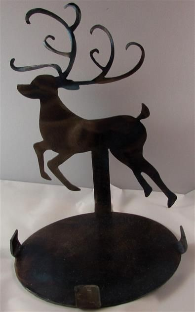 Hand Torch-colored Reindeer candle holder made from 14 gauge steel. These cast a shadow of the image when candles are lit.the torch colors really come out in natural or artificial lighting.