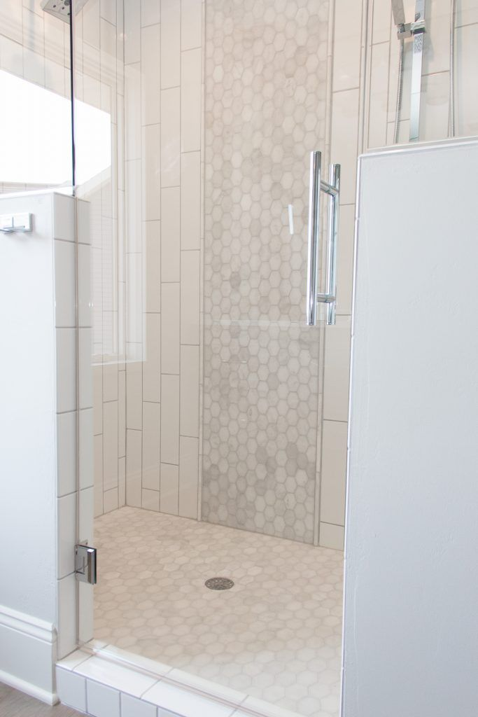 White Subway Tiled Shower with Hexagon Tile