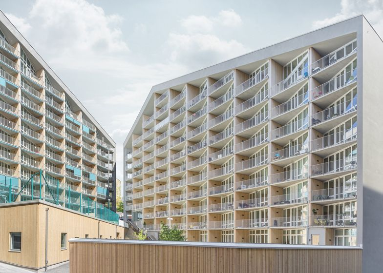 joliarks twin pitched roof apartment blocks look onto courtyard