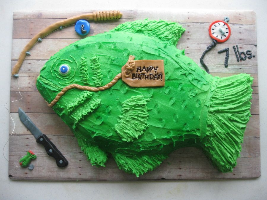 Carved fish cake iced with buttercream and foundant for Fishing cake ideas