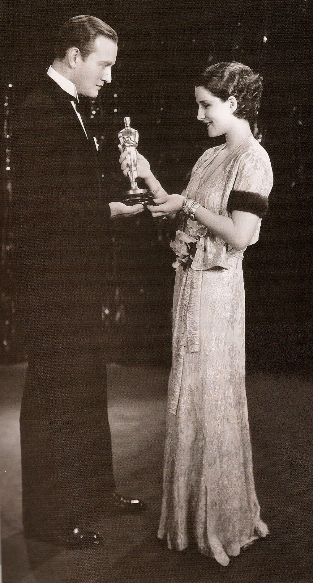 Norma Shearer and John Wayne at the 1930 Oscars