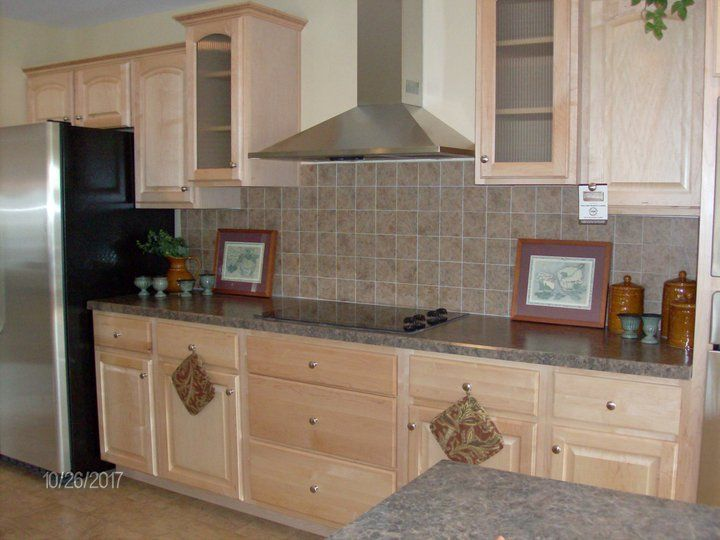 Our model has natural maple cabinets and a full ceramic ... on Kitchen Backsplash With Natural Maple Cabinets  id=63955