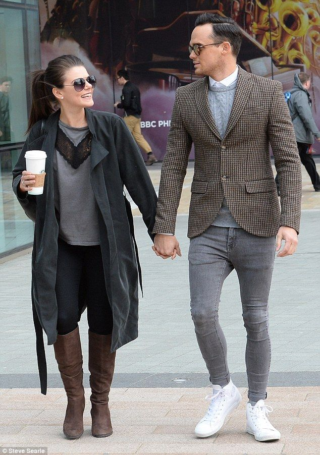 Affectionate: The pretty Coronation Street actress looked lovingly at her beau as they wen...