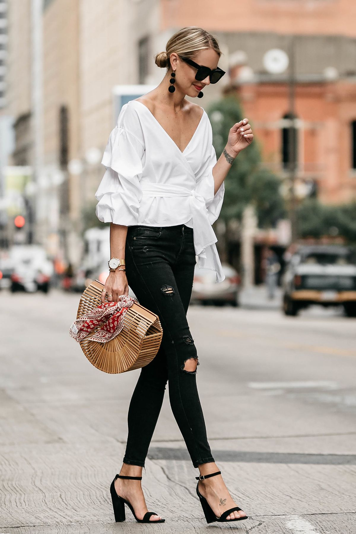 Last year, wrap blouses appeared in a new version. The top looks more stylish due to the statement sleeves and bow that ties at the waist. There couldn't be another result other than it becoming a trend.