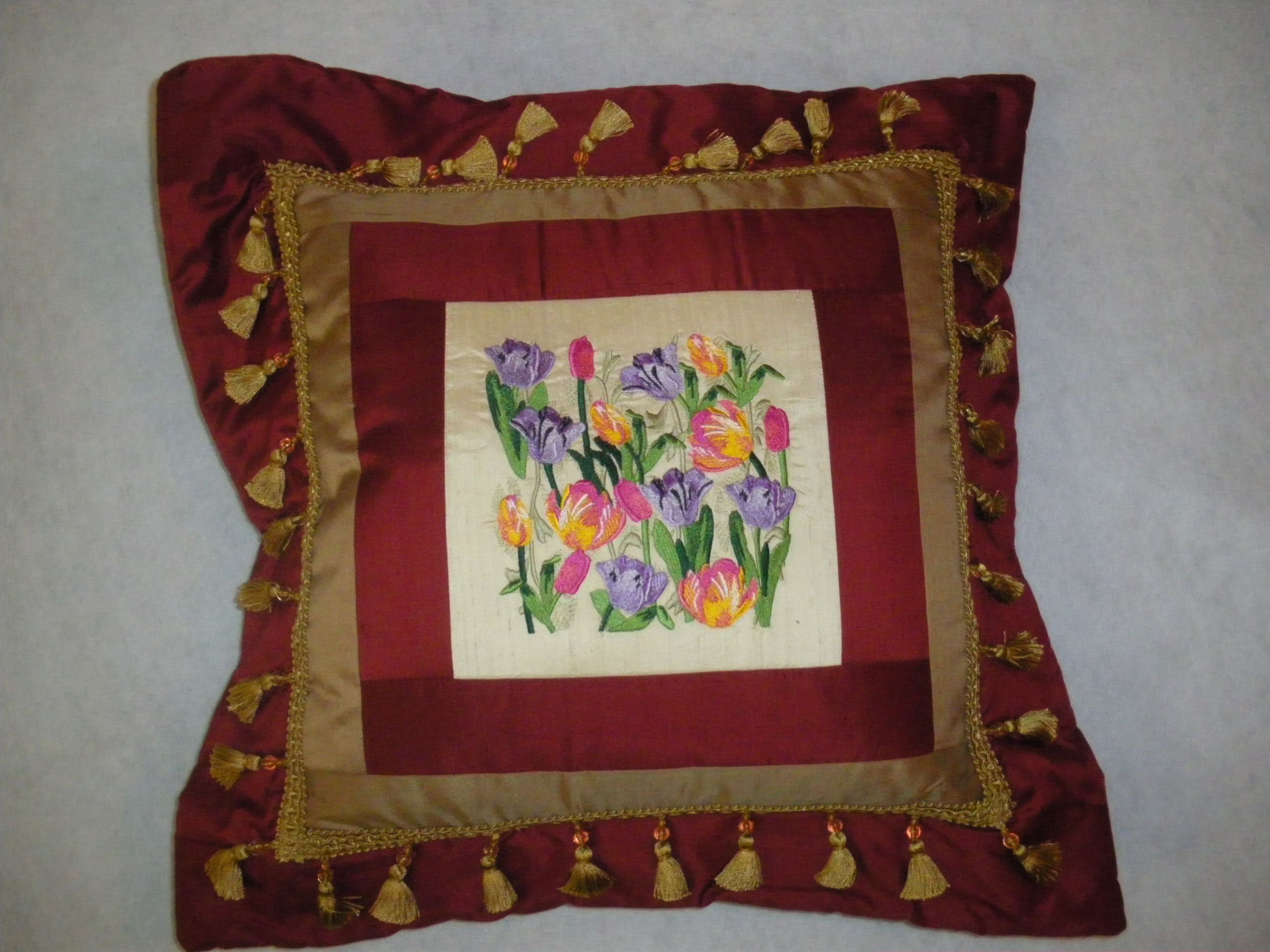 Embroidered pillow using a design from Embroidery Library