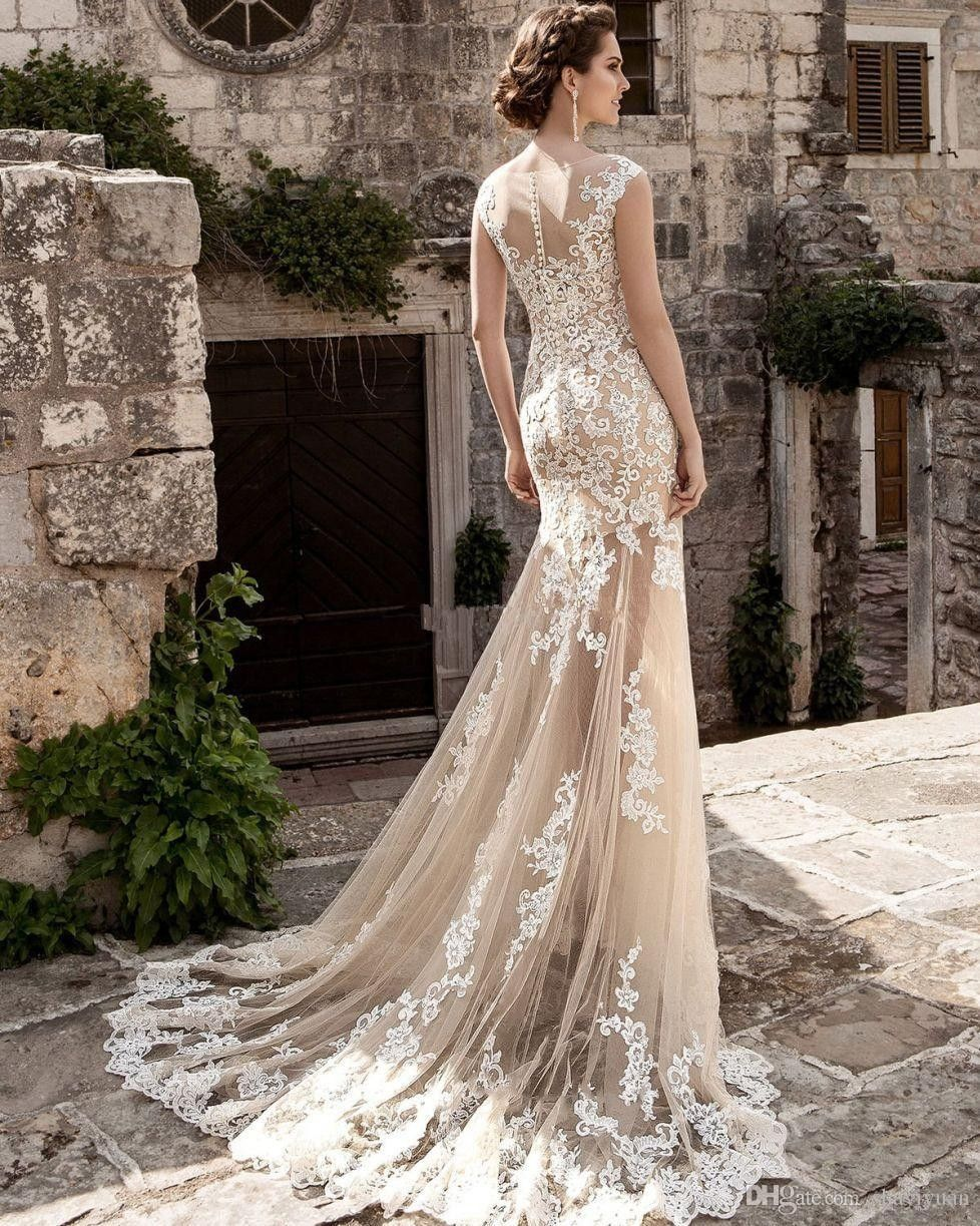 Champagne and ivory wedding dress  Pin by Eirini Tsavdaridou on что то тайное есть в тебе  Pinterest