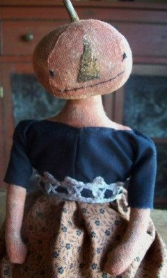 This is a primitive doll handmade and found on The Red Cupboard shop.