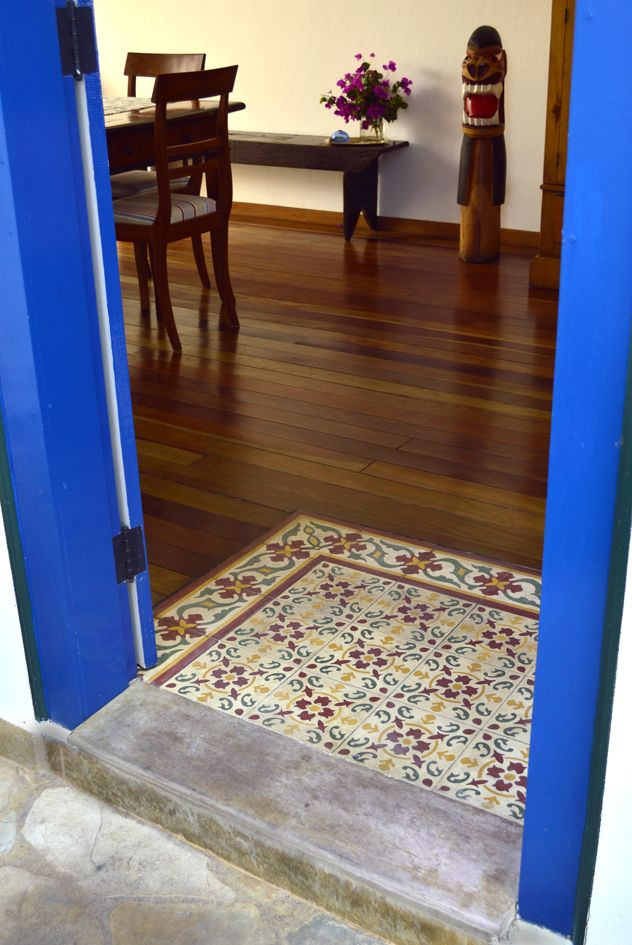 Here The Cement Tiles Form A Transition Area Between Outside And Wood Floor Of