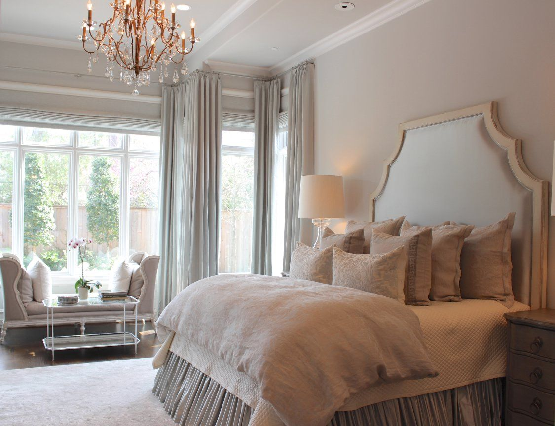 Chic French master bedroom boasts gray silk