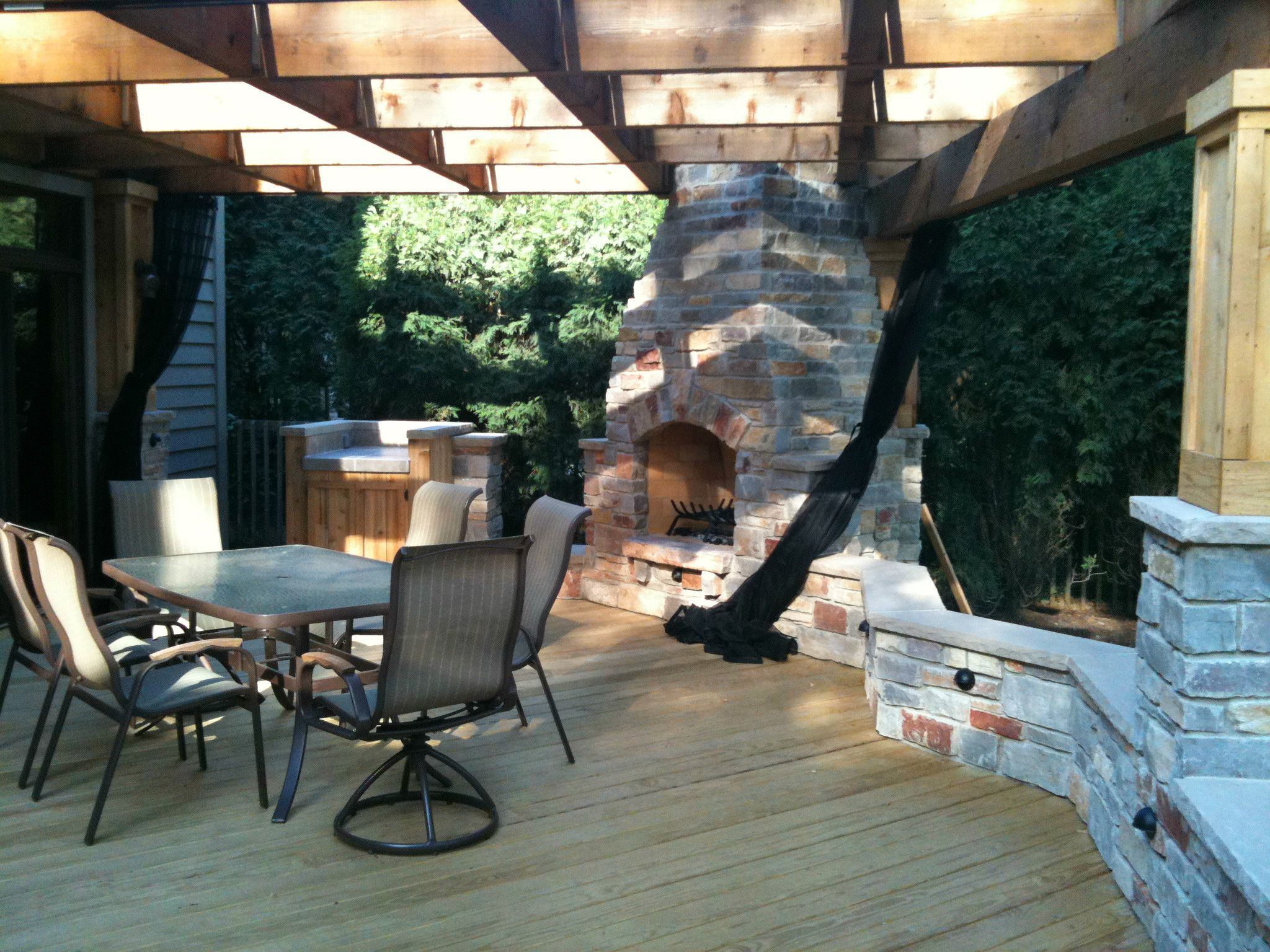 Deck Design with Outdoor Fireplace by Chicagoland Deck Builder