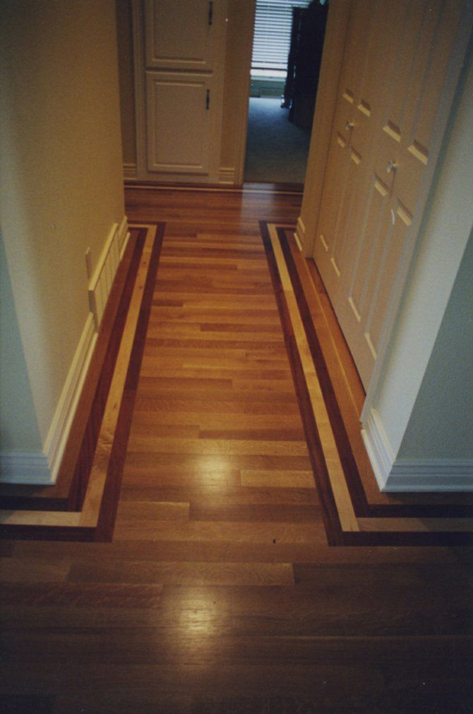 hallway floor where all the wood goes one direction