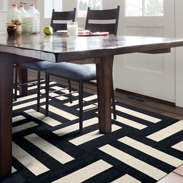 internal rug debate simple black and white geometric or ethnic red and ornate