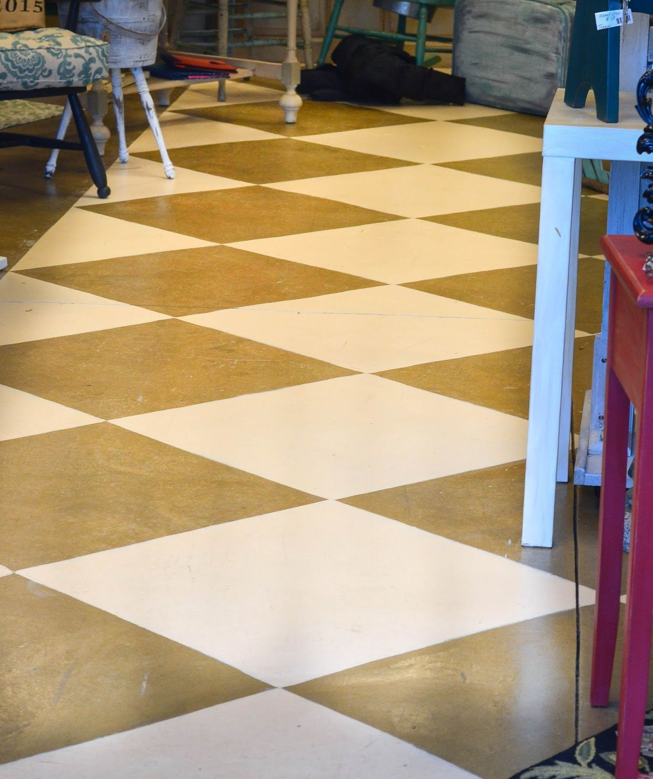 Cement diamond painted floors and shop pics diamond paint painted painted concrete floor a diamond pattern painted over the existing floor finish this is an inexpensive way to give your floors a new look dailygadgetfo Images