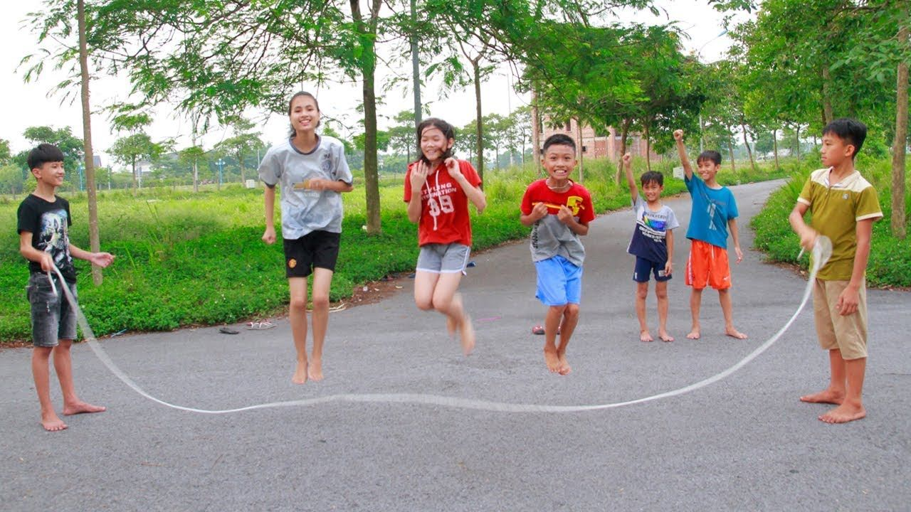 Kids Plays with Classic Games Jump Rope in the Outdoors
