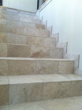 Travertine Staircase Trimmed With Cordoba Cream Trim Along The Wall. Shown  On These Stair Treads