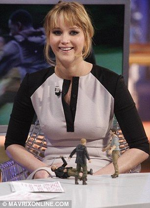 More Jennifer Lawrence and action figures.