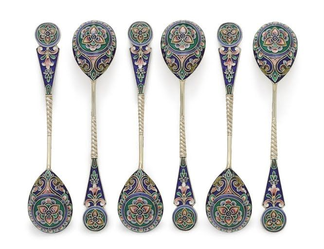 A Set of Six Silver-Gilt and Cloisonné Enamel Teaspoons  Mark of the 11th Artel, Moscow, 1908-1917  Bowl and terminal decorated with varicolor shaded flowerheads and foliate scrolls on dark blue ground, with spiral twist stem, marked on stem 5 in. (12.7 cm.) long (6) Related Lots