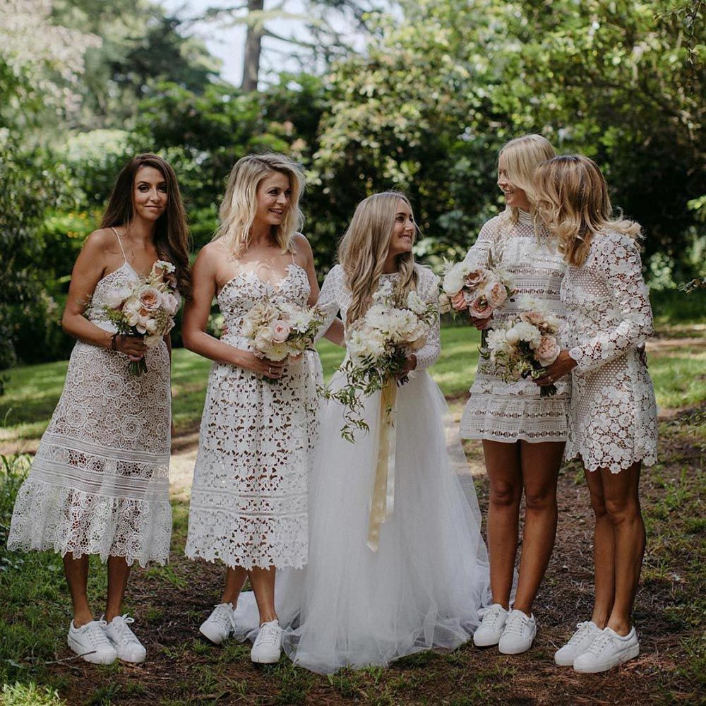 32 All White Bridesmaid Dresses That Are Totally Slaying The Game Ruffled White Lace Bridesmaid White Bridesmaid Dresses Bridesmaid Dresses Boho