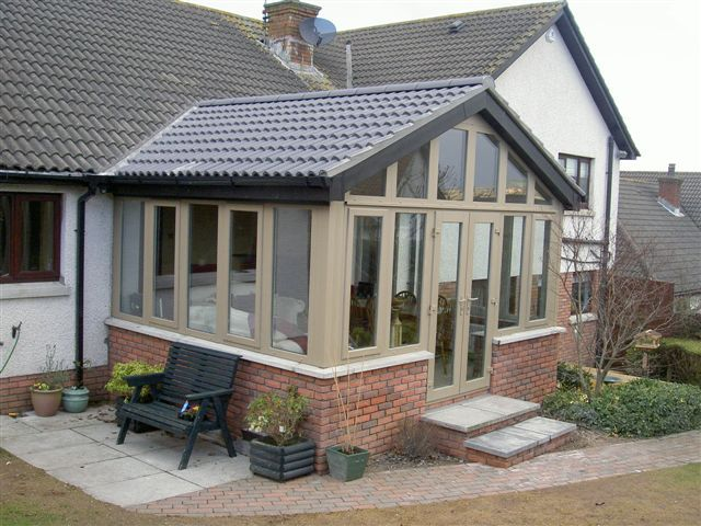 Pin By P Wells On Conservatory Solid Roof Bungalow House Design Mediterranean House Designs Porch Extension