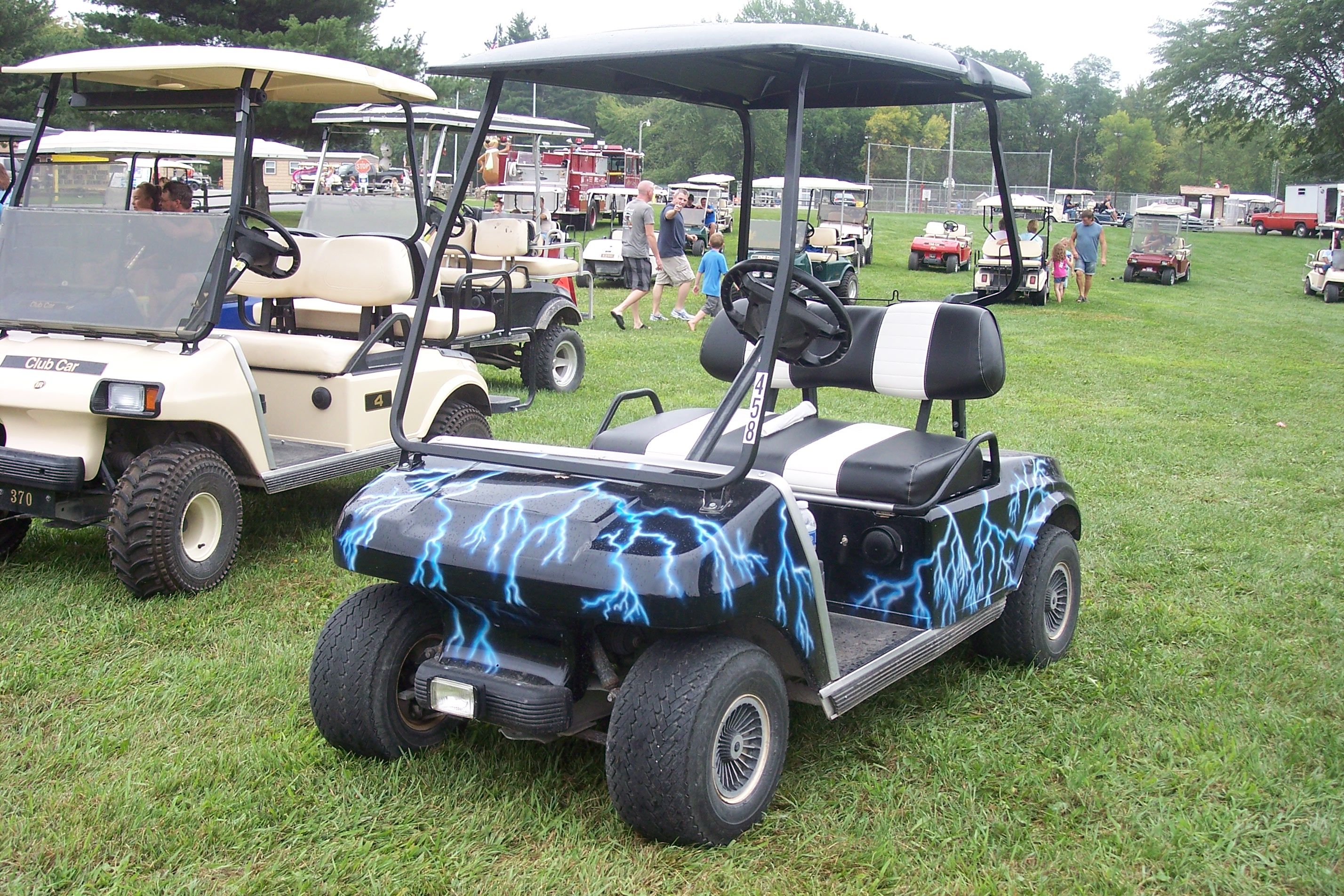 My custom golf cart which I painted with blue lightening on a black on custom silver golf cart, custom car golf cart, custom red golf cart, custom black golf cart, custom body golf cart, custom paint golf cart, custom graphics golf cart,
