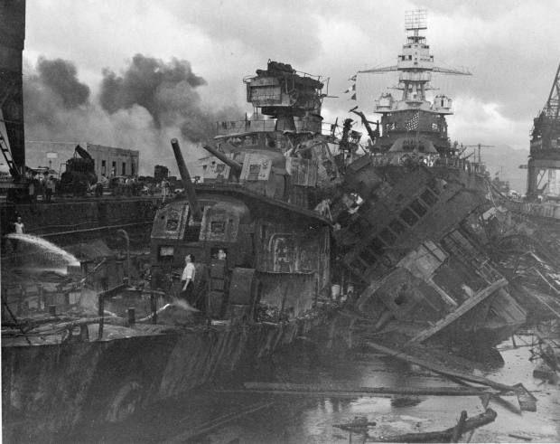 This Dec. 1941 photo shows heavy damage to ships stationed at Pearl Harbor after the Japanese attack on the Hawaiian island on Dec. 7, 1941. The most comparable attack against the United States was the surprise Japanese bombing of Pearl Harbor on Dec. 7, 1941