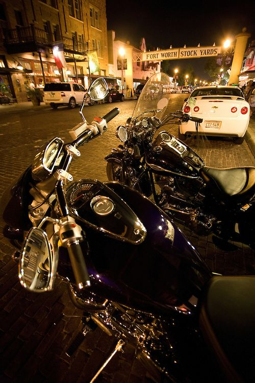 Harley davidson motorcycle parked on the cobblestone for Harley davidson motor credit