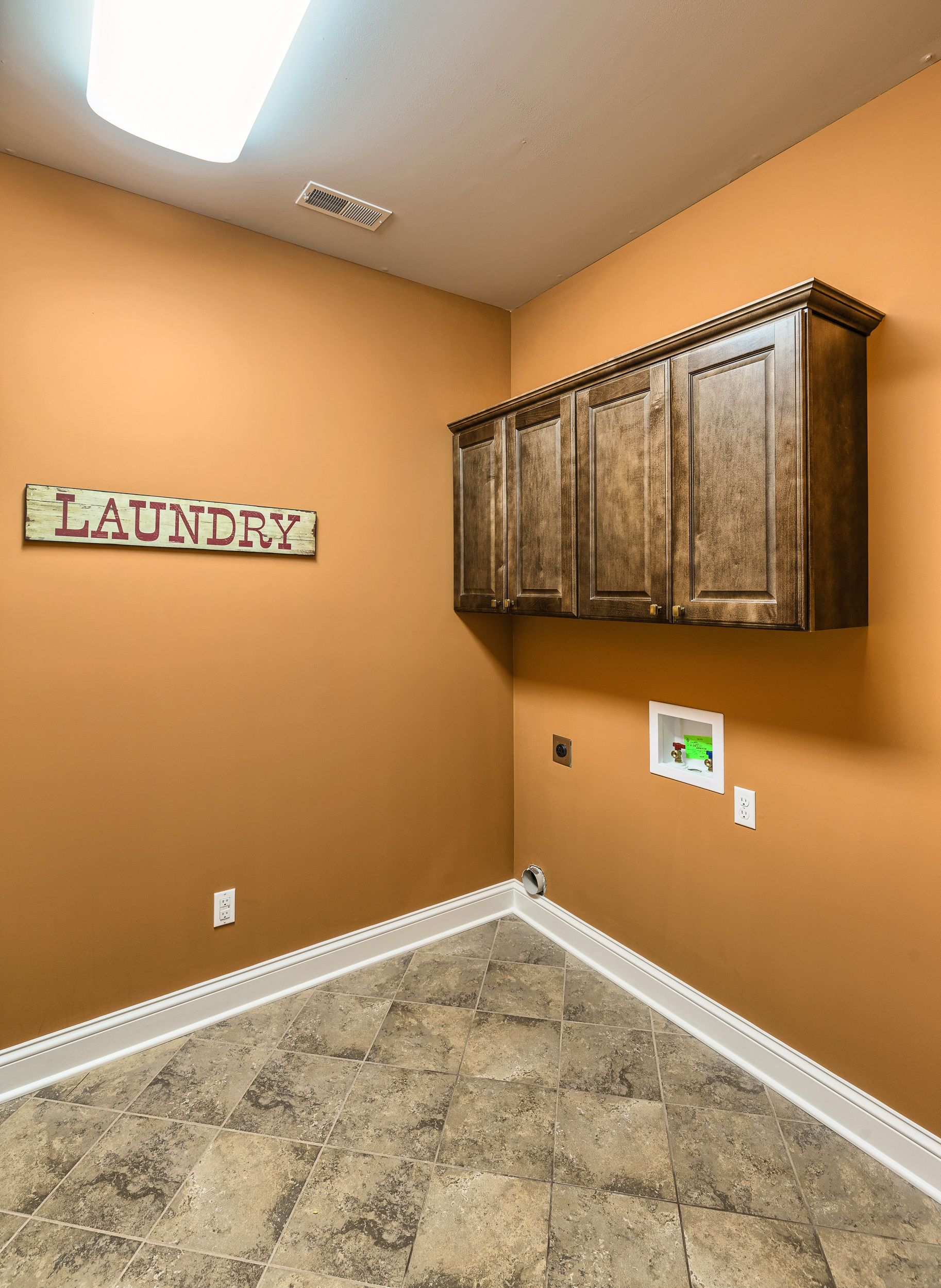 Laundry room with cabinet storage.