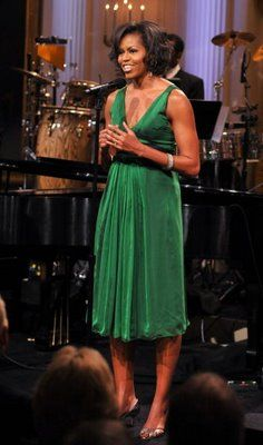 Our First Lady was ahead of the trend in this 2009 photo sporting a lovely emerald green dress!