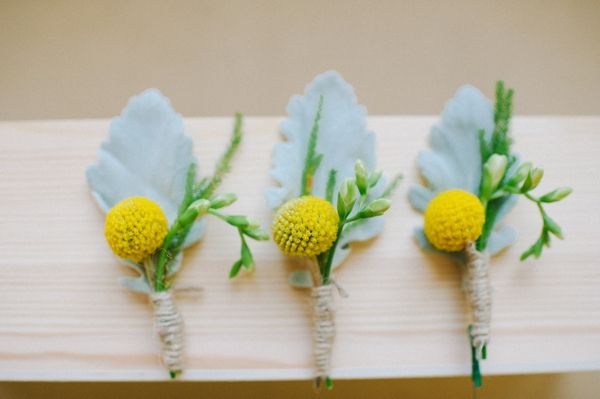yellow boutonnieres http://www.weddingchicks.com/2013/09/17/wedding-in-white-and-yellow/