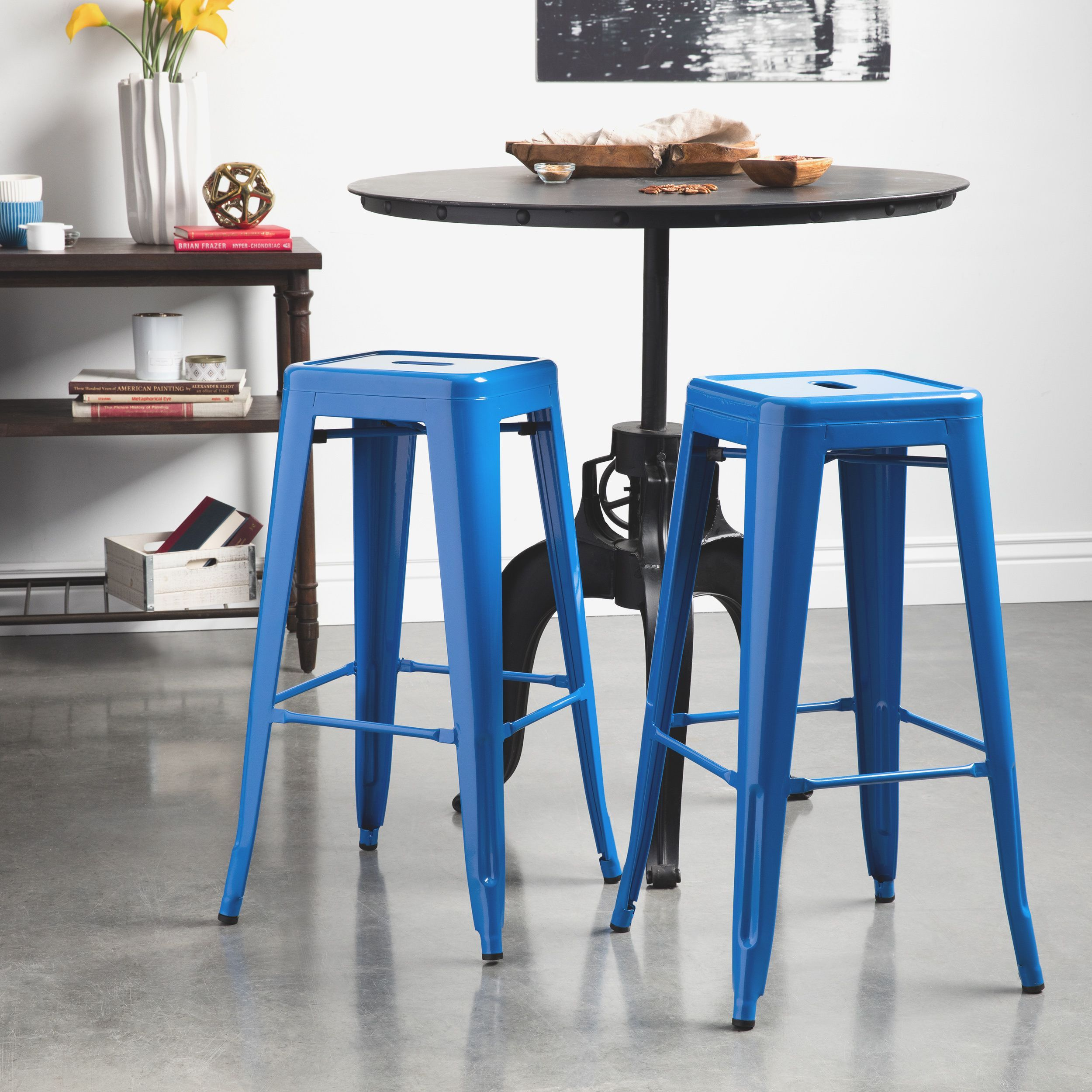 These metal bar stools come in a rich blue color with a glossy ...