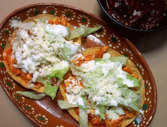 Tostadas de Tinga (cooked and shredded chicken, roma ...