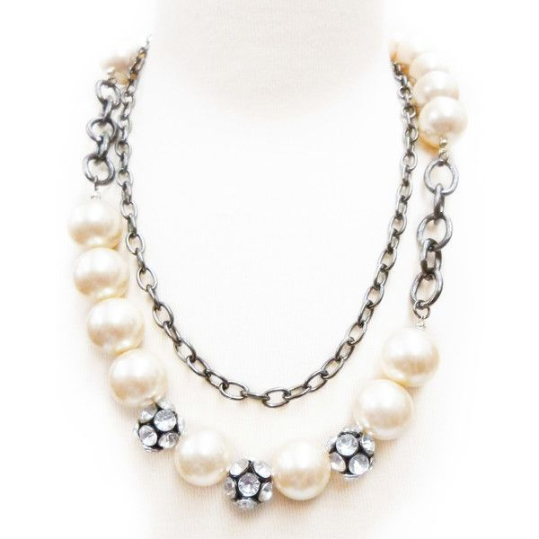 Definitely pretty, but in no way dainty. This mix of pearls and chains are perfect with jeans and a tee . . . or as the finishing touch on a one-shouldered dress: Metal, Acrylic, and Pearl Necklace via @Lydell NYC