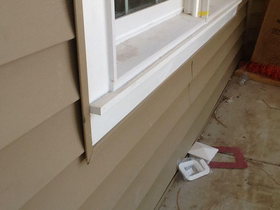 Azek pvc window trim with apron sill with dark tanclay