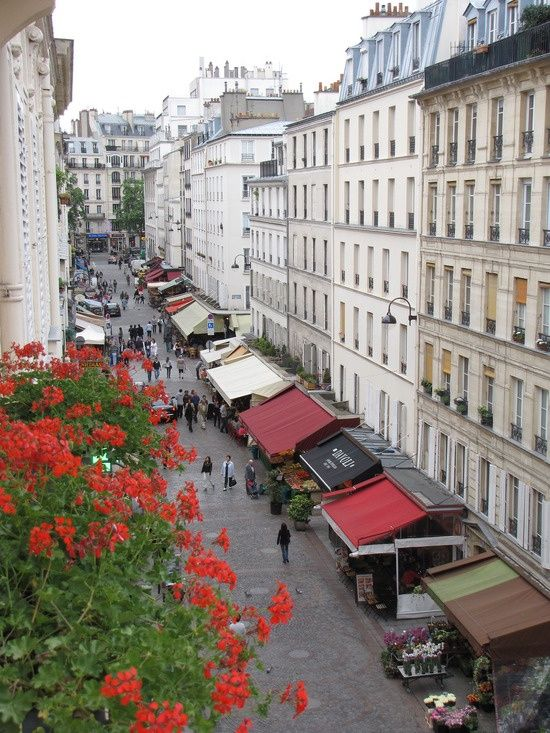 Rue Cler...Paris. This must be an old photo Rue Cler now has lights strung down its length.