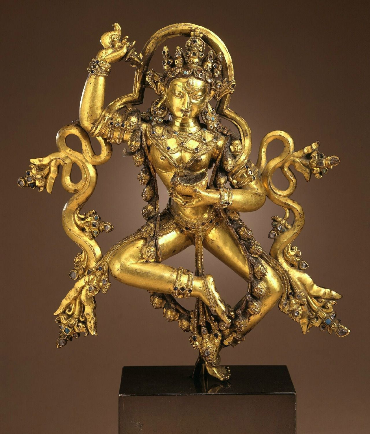 16th century, Central Tibet, Densatil monastery, gilt copper alloy with stone inlay