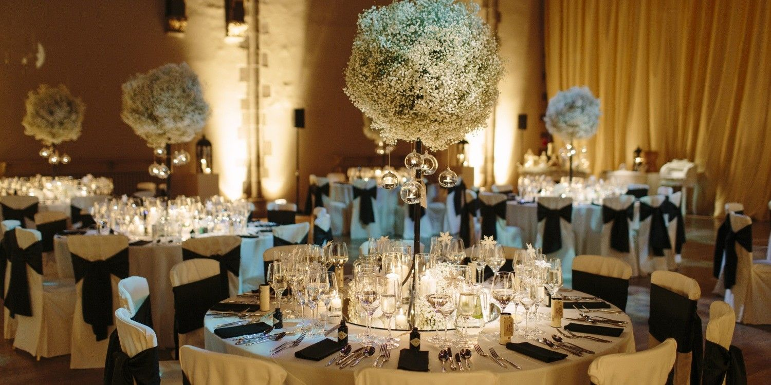 Tall poof center piece w very narrow vase so people can see weddings junglespirit Images
