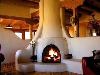 Dramatic Wood Burning Kiva Fireplace Is Central Anchor For Extreme Southwest Ambiance Casa Pajaro Taos Re Adobe House Southwestern Home Southwest Living