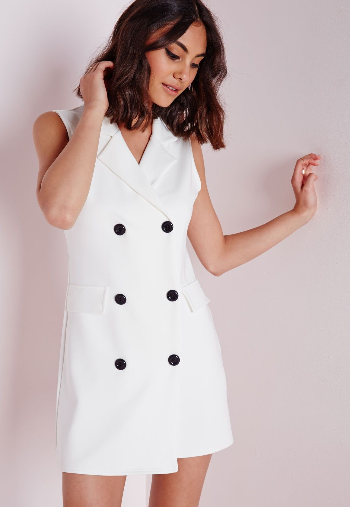 Look fierce this season in this white blazer dress. In a figure ...