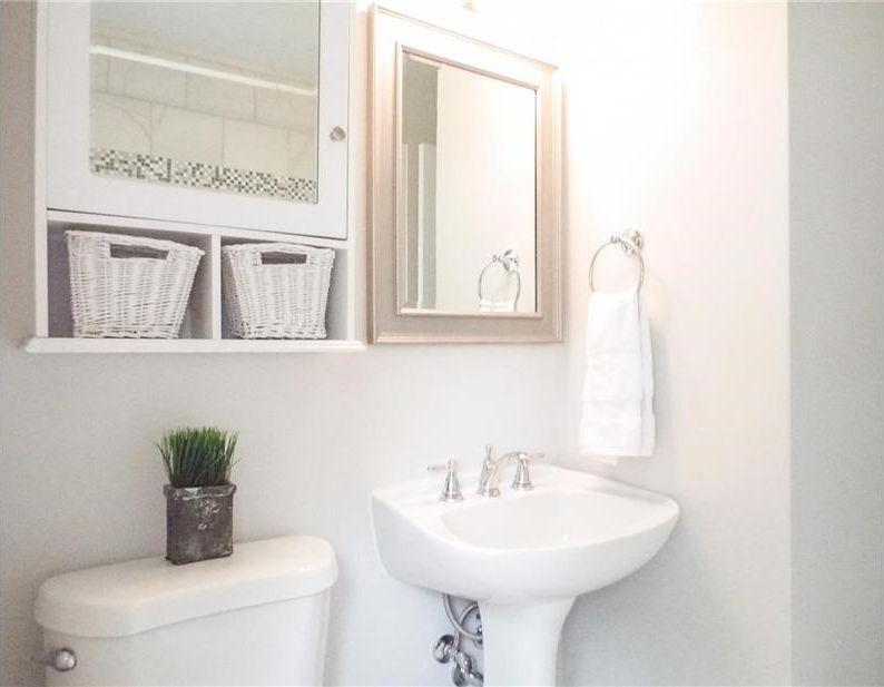 Traditional Powder Room With Pedestal Sink White Medicine Cabinet With Wicker Baskets Built In Bookshelf Hi Bathroom Decor Wicker Headboard Wicker Furniture