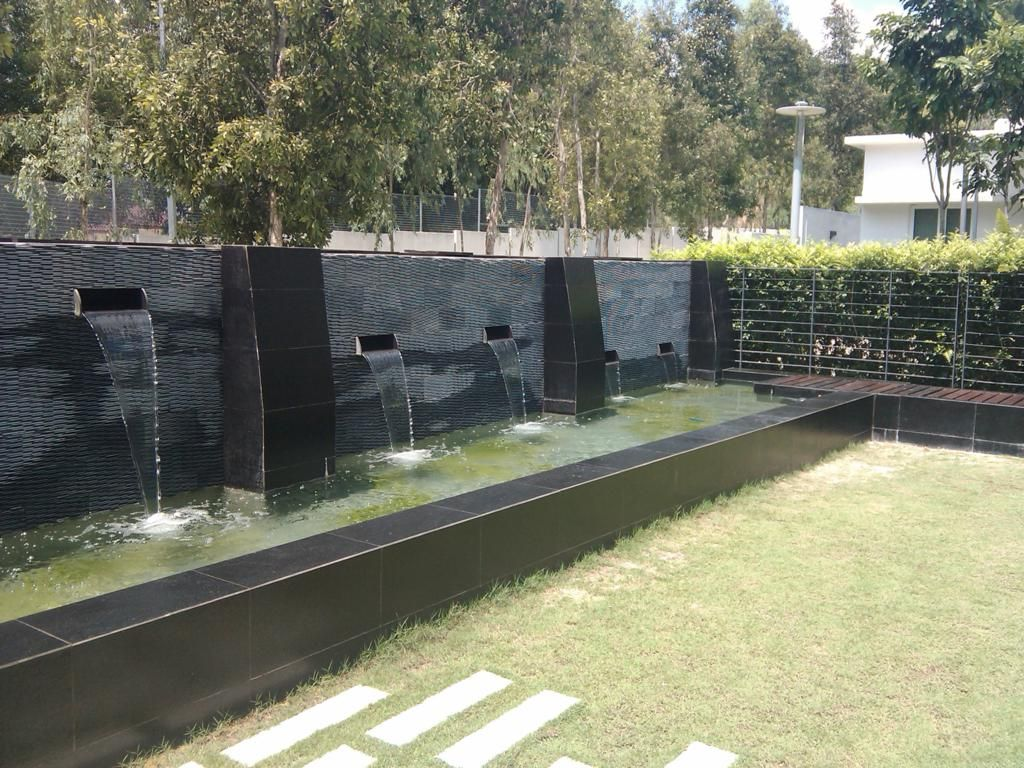 Fish pond designs with waterfalls and modern outdoor fish for Modern pond waterfall